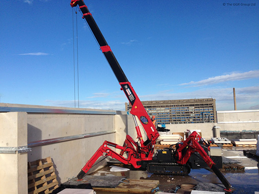 Spider Crane Climbs Up To Rooftop For Cladding
