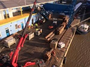 UNIC Mini Spider Crane Unloads Cruise Passenger Luggage