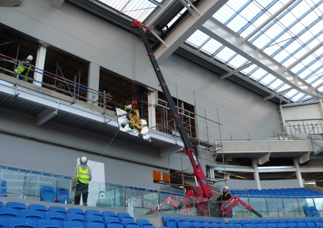 This URW-095 mini spider crane helped fit glass in some VIP viewing at Brighton's Falmer Stadium
