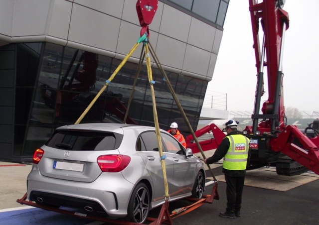 A 1006 mini crane helped lift this Mercedes Benz car onto the rooftop at Silverstone