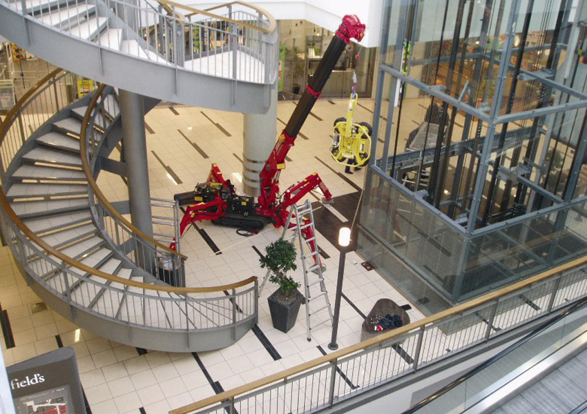 Working in Denmark this URW-095 mini spider crane and MRT4 vacuum lifter helped glaze a lift shaft