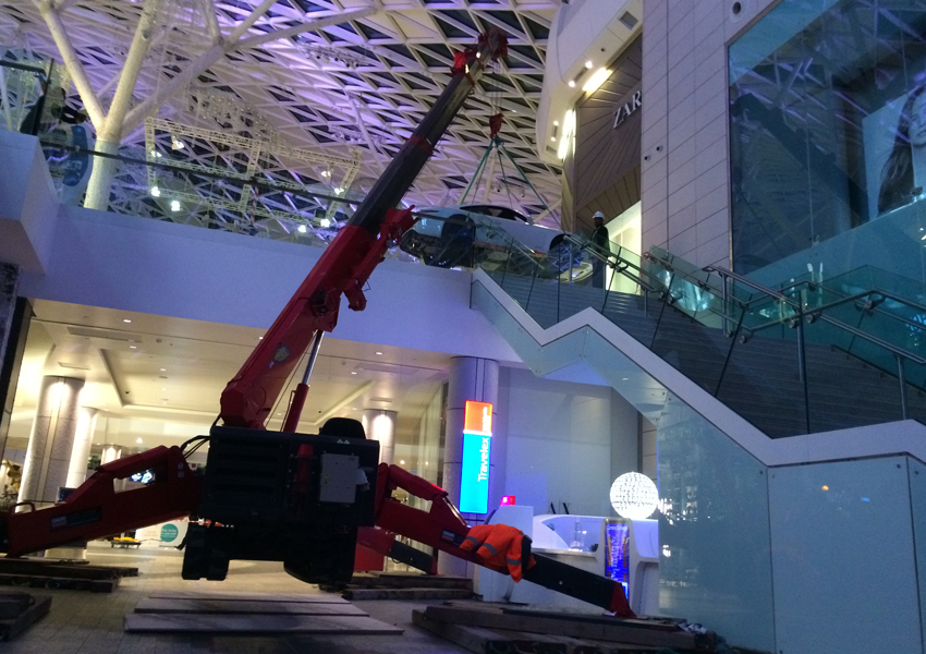 Lifting a supercar into the Westfield Shopping Centre was no problem for this URW-706 crane